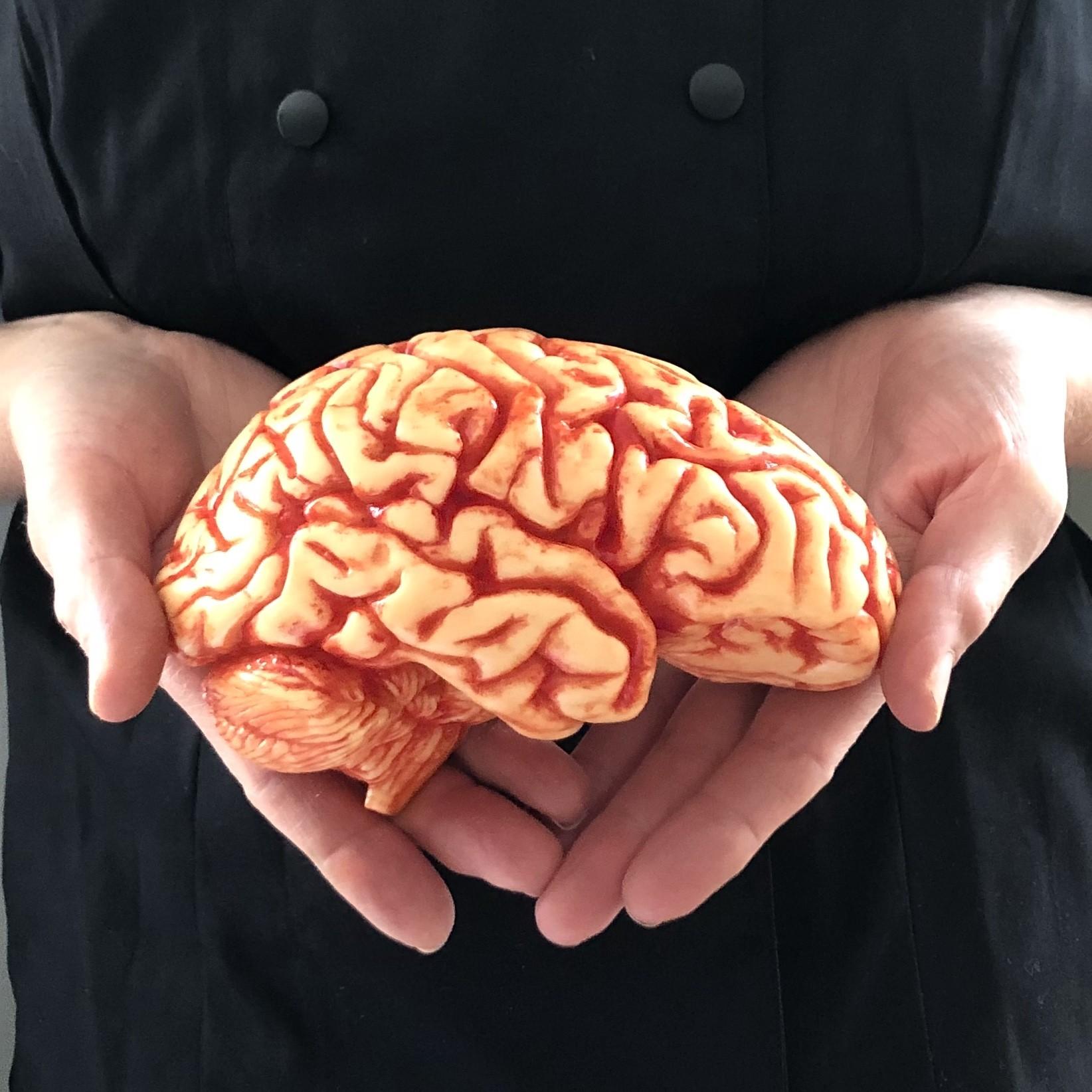 chocolate brain held in hands